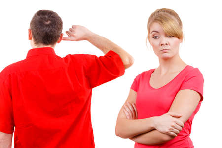 impasse: Couple having argument, conflict bad relationships. Angry offended woman and man standing with fingers in his ears not listening Stock Photo