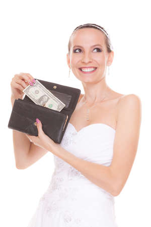 savings problems: Bride with one dollar and wallet. Young girl holding purse and money cash. Wedding expenses costs, expenditure. Marriage and finance concept. Woman in white wedding dress isolated on white background. Stock Photo