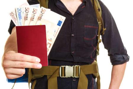 spendthrift: Tourist backpacker holding passport full of money. Human hiker backpacking. Summer vacation travel. Isolated on white background. Stock Photo