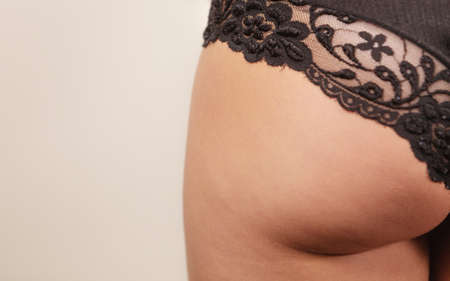 lace panties: Perfect buttock, beautiful fit female body. Closeup young woman in black lace panties rear view Stock Photo
