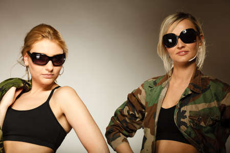sexy army: two sexy women in military clothes army girls on gray