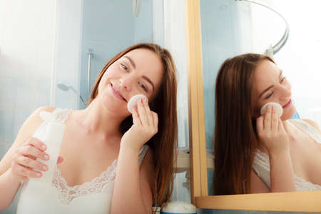 swab: Woman removing makeup with cotton swab pad. Young girl taking care of skin. Skincare concept. Stock Photo