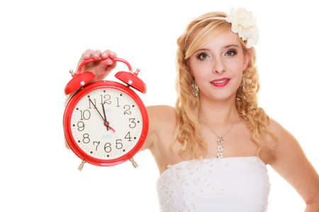 groom and bride: Wedding concept. Time to get married. Bride with red alarm clock. Beautiful blonde woman waiting for the groom isolated on white