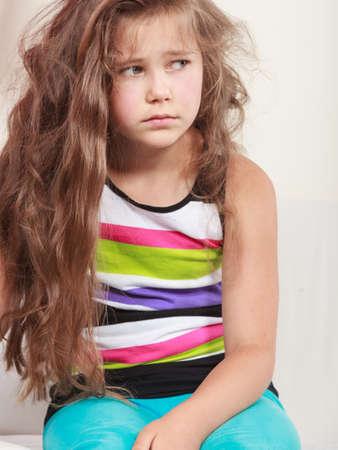 bad mood: Portrait of sad unhappy little girl kid. Lonely depressed child. Bad mood.