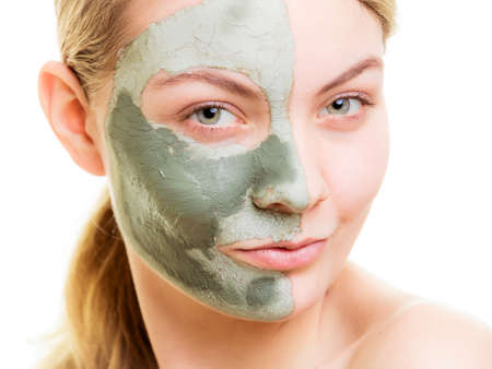 mud woman: Skin care. Woman in clay mud mask on face isolated on white. Girl taking care of dry complexion. Beauty treatment. Stock Photo