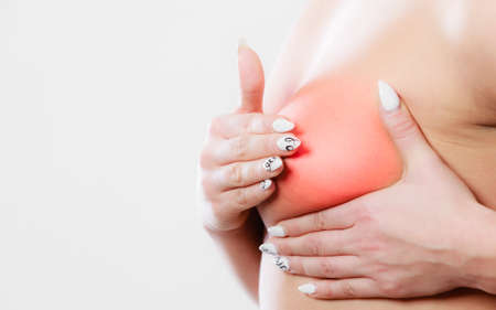 Health care medical concept. Close up young woman examining her for lumps or signs of cancer