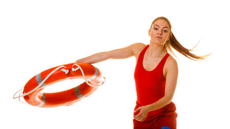 Lifeguard with ring buoy lifebuoy. Woman supervising swimming pool water. Accident prevention. Stock Photo