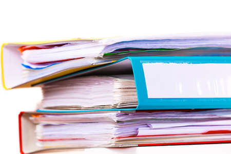 ring binders: Paperwork. Stack of file folders, ring binders on office table dask. Stock Photo