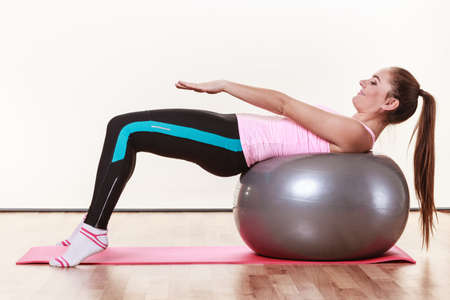 girl working out: Fit girl working out. Young woman exercising in gym. Health fitness activity concept. Stock Photo