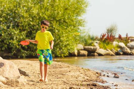enjoyable: Play and fun concept. Little playful enjoyable boy kid Stock Photo