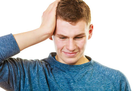 holding on head: Negative human emotions, facial expressions, reaction attitude. Closeup stressed man holding head with hands isolated Stock Photo