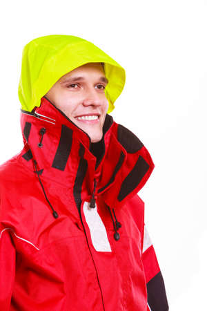 outdoorsman: Hooded man in waterproof jacket. Young male outdoorsman in protective clothing. Adventure danger outdoors concept. Stock Photo