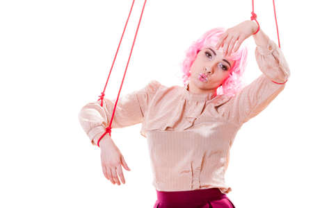 puppeteer: Young woman girl stylized like marionette puppet on string