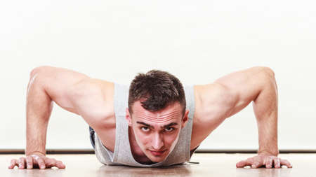 care about the health: Sports man making pushups,. Care about health and body Stock Photo
