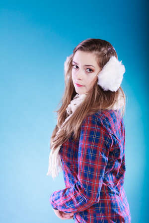 earmuff: Teenage girl wearing fluffy white earmuff in winter fashion, cold time. Stock Photo