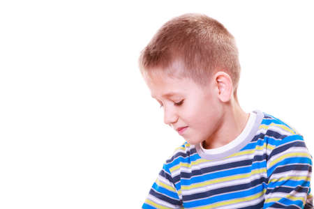 daydream: Emotions and thinking calm daydream. Little boy absorbed calm and pensive alone.