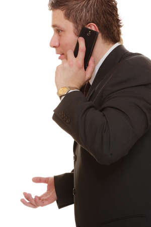 misunderstanding: Technology and communication - confused businessman talking on mobile cell phone smartphone, worried man using cell phone isolated. Misunderstanding.