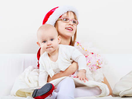 relatives: Family people siblings concept. Two beautiful sisters together. Spending christmas time with relatives. Loving familiar moments. Stock Photo