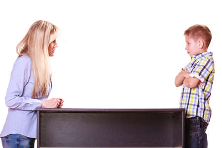 disobedient child: Relationships arguments and discussion. Mother and son sit at table and argue discuss solve problem. Stock Photo