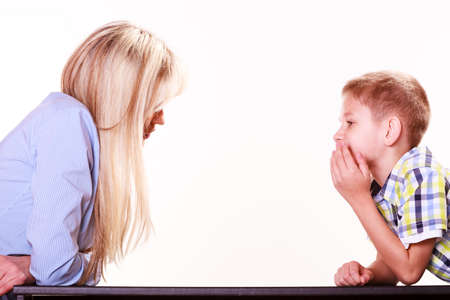 discuss: Relationships arguments and discussion. Mother and son sit at table and argue discuss solve problem. Stock Photo