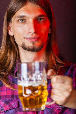 taphouse: Alcohol liquor drinking party relax concept. Man holds glass of beer. Person holding stein filled with ale.