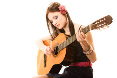 an entertainer: Travel vacation concept. Music lover summer girl playing acoustic guitar isolated on white background