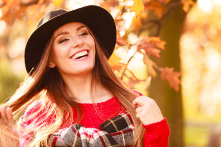 head scarf: Autumn season people concept. Portrait of attractive woman. Beautiful lady wearing black hat and checkered scarf.