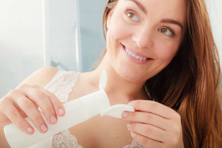 Woman removing makeup with cotton swab pad. Young girl taking care of skin. Skincare concept. Stock Photo