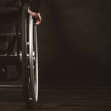 coping: Part of wheelchair with arm. Disability psychology coping concept
