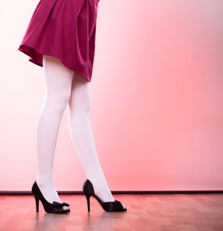 hosiery: Elegant fashion outfit. Fashionable woman long legs in white color pantyhose black shoes