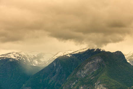 hiils: Tourism vacation and travel. Mountains landscape, stormy cloudy sky, Norway, Scandinavia. Stock Photo