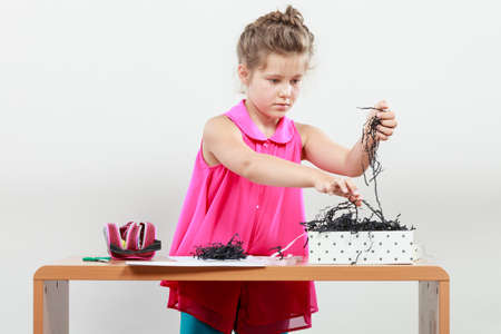 elementary age: Little girl create work in the classroom. Being creative in elementary age Stock Photo