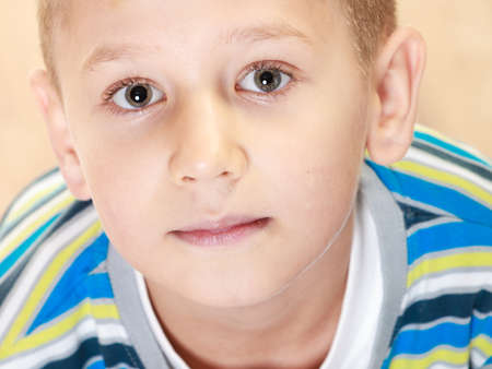 high angles: Unusual high angle view of little pensive boy child looking at camera Stock Photo