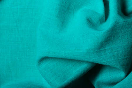 folds: Blue green background abstract cloth wavy folds of textile material