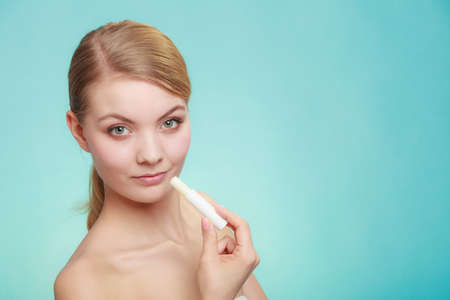 balsam: Female putting applying lip balm moisturizing balsam. Girl taking care of lips. Skincare. Stock Photo
