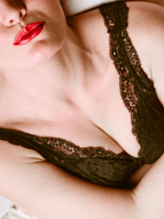 bust: Closeup of woman girl bust chest and red lips. Stock Photo