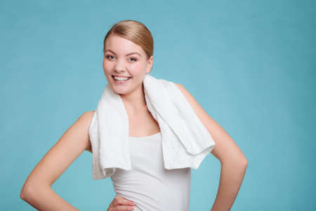 hygien: Wellness health care and clean body. Young woman happy after shower. Hold towel on shoulders smiling.