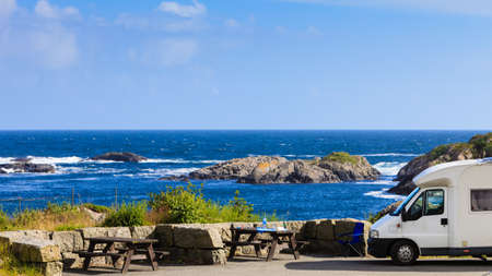 Tourism vacation and travel. Camper van and rocky coast landscape of southern Norway with an ocean view in Rogaland county Norway. Stockfoto