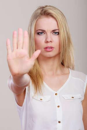 denial: Woman saying stop. Girl showing denial hand sign gesture.