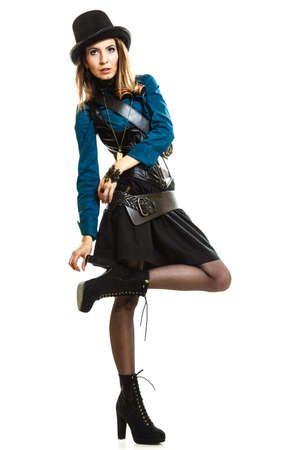 Young steampunk islolated girl on white wearing fancy hat. Fantasy old fashion with stylish topper and goggle posing.