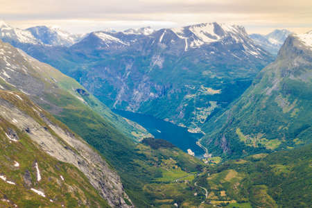 fantastic view: Tourism vacation and travel. Fantastic view on Geirangerfjord and mountains landscape from the Dalsnibba Plateau viewpoint, Norway Scandinavia. Stock Photo