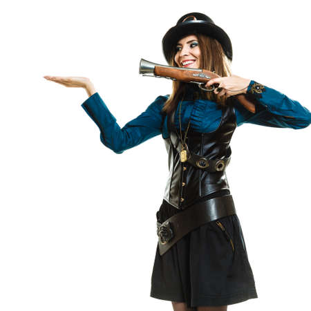 steampunk goggles: Retro old fantasy fashion style. Young pretty smiling woman with vintage pistol isolated on white.