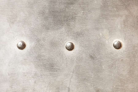 armoring: grunge metal plate or armour texture with rivets as background