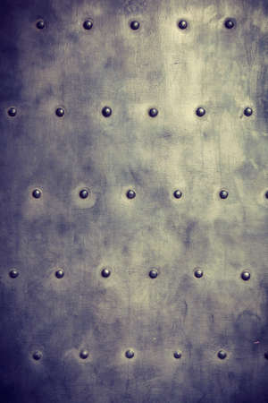 rivets: grunge metal plate or armour texture with rivets as background
