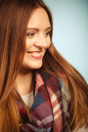 checkered scarf: Fashion, clothing concept. Beautiful woman with checkered scarf. Close up picture with young lady wearing fashionable clothes. Stock Photo