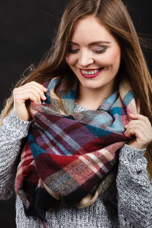 checkered scarf: Clothing people fashion concept. Attractive woman wearing checkered scarf. Picture of nice lady taken in the studio.