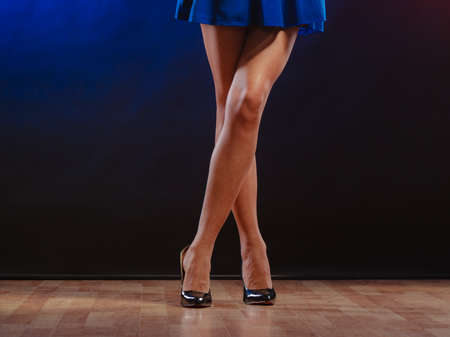 club dress: New year, celebration, disco concept - woman in evening dress dancing in the club, part of body female legs in high heels on party floor
