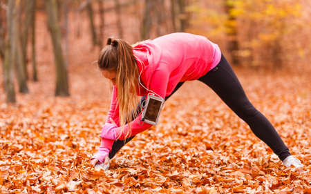 Woman exercising in the forest, nature fitness and health concept