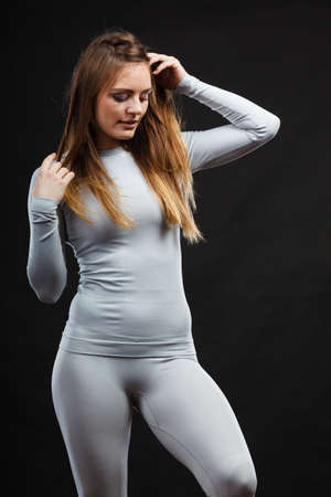 Clothing fashion sport concept. Woman wearing thermoactive underwear. Attractive sporty lady promoting clothes.
