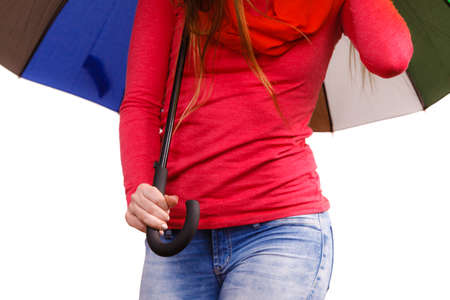 forecasting: Woman standing under colorful umbrella. Meteorology, forecasting and weather season concept